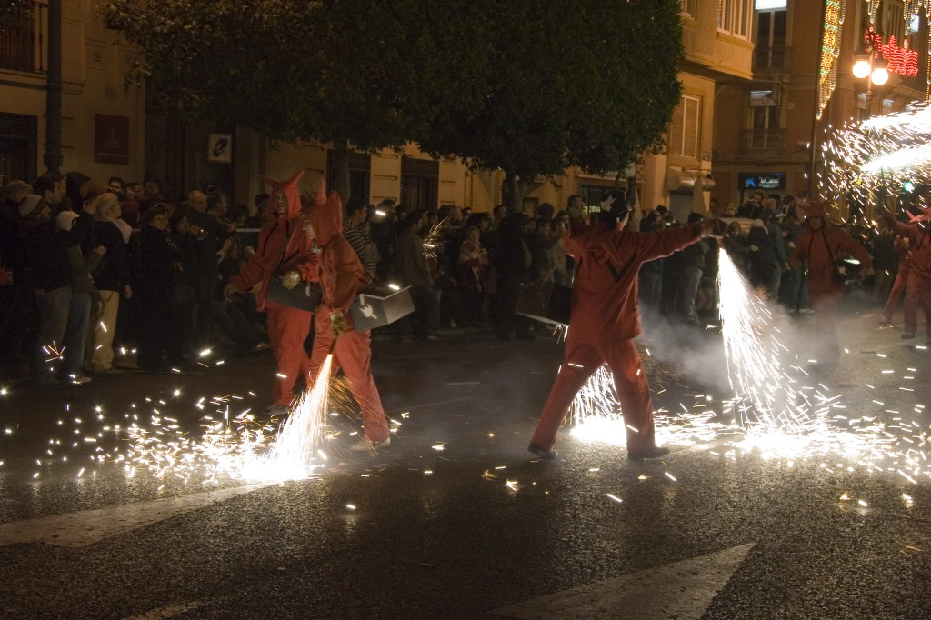 Red devils spraying sparks on the street