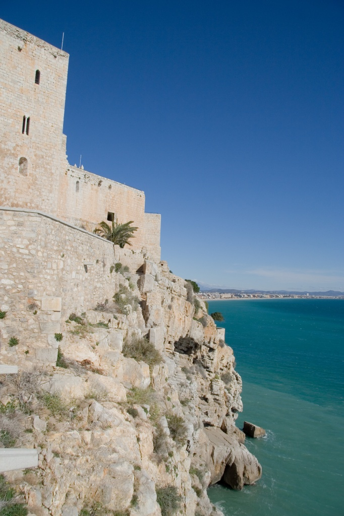 Castle walls fortify the sea