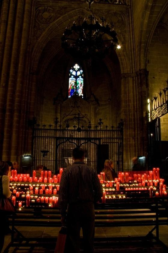 Lighting candles in the Cathedral of Santa Eulàlia