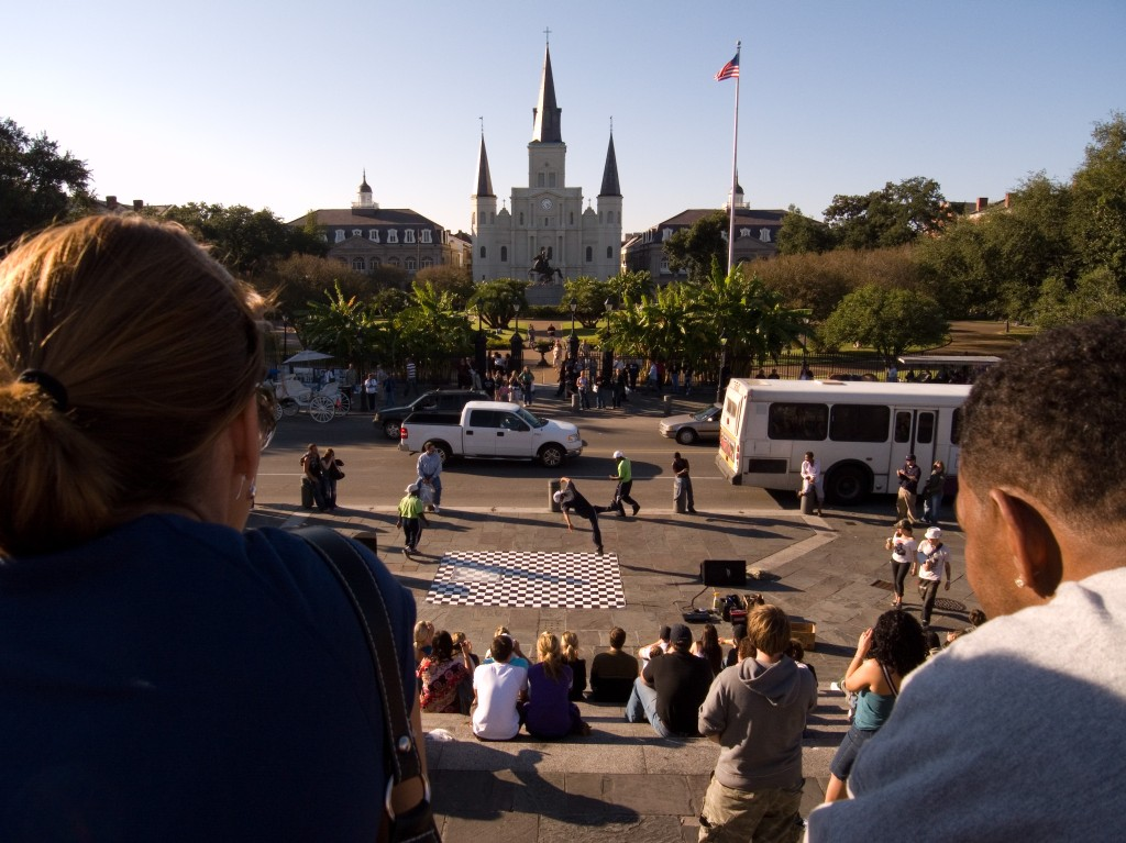 Watching performers outside Jackson Square