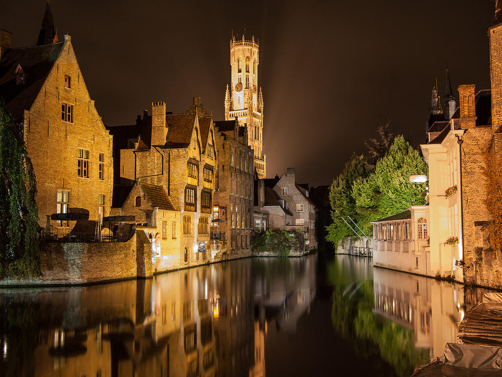 Belfry and canal reflections at night