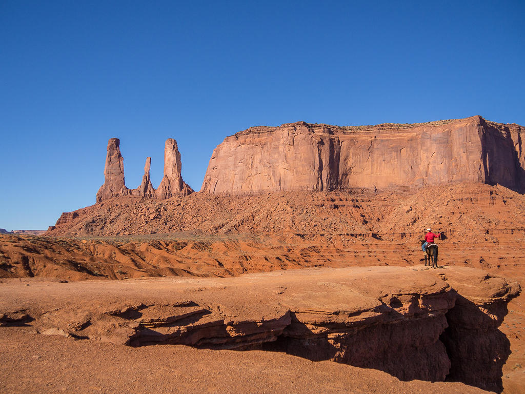 Cowboy photo op and Monument Valley's Three Sisters
