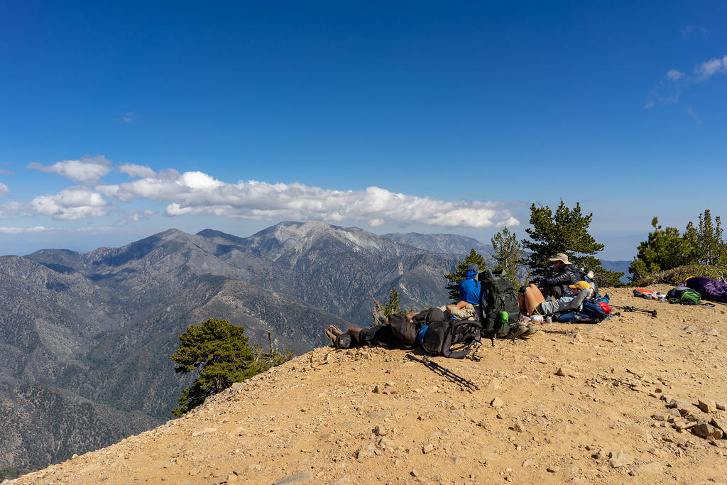 Through hikers resting on the summit