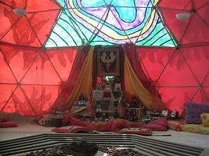 Taking refuge from a dust storm in this dome out on the playa done up to be a shrine