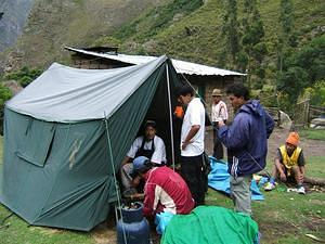 Porters preparing lunch.  This was luxury camping.