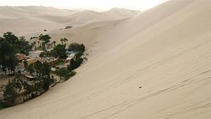 Climbing the dunes of Huacachina (not easy)
