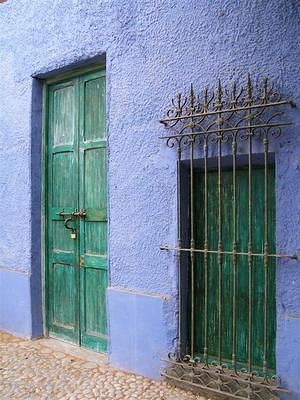 Blue wall, green door and window