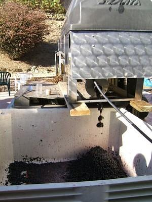 Out of the destemmer, into the grape mash bins