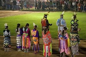 Fancy Shawl and Jingle Dress dancers in the powwow grand entry