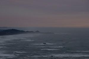 Yaquina Head Lighthouse in the distance