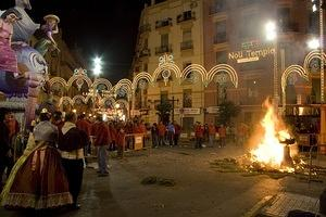 The casal watches the burning falla