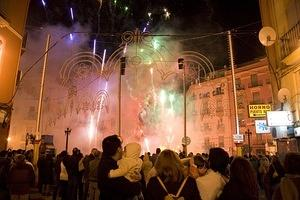 A falla starts to burn with fireworks