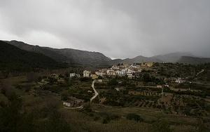 Storm rolls in on a mountain town along CV-20