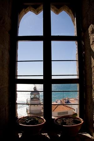Window looking out at the lighthouse