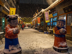 Snowy street food shops off Wangfujing Street