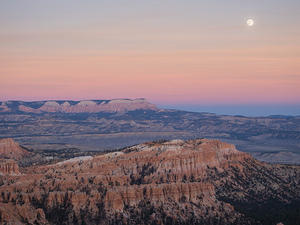 Moon over dusky canyons