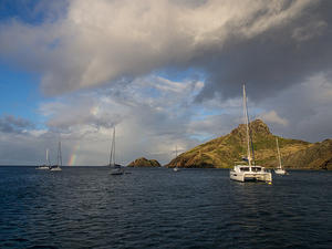 Rainbow and anchored boats at Île Fourchue