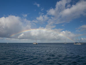 Rainbow over catamarans